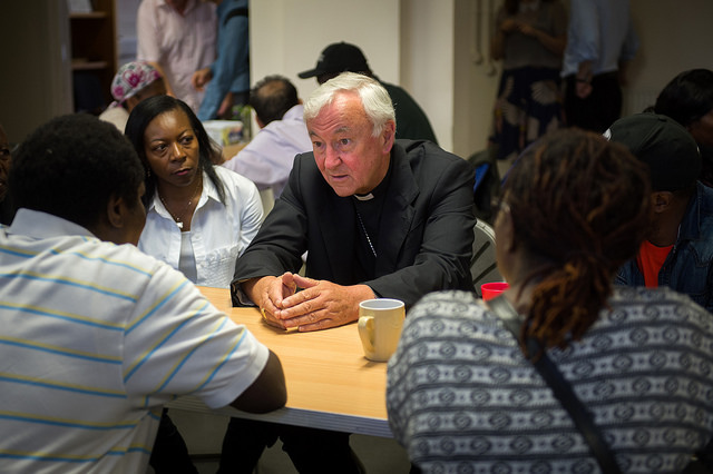 Cardinal Vincent Nichols spends time with refugees accompanied by JRS